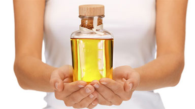 bottle of cosmetic Argan Oil for hair conditioning