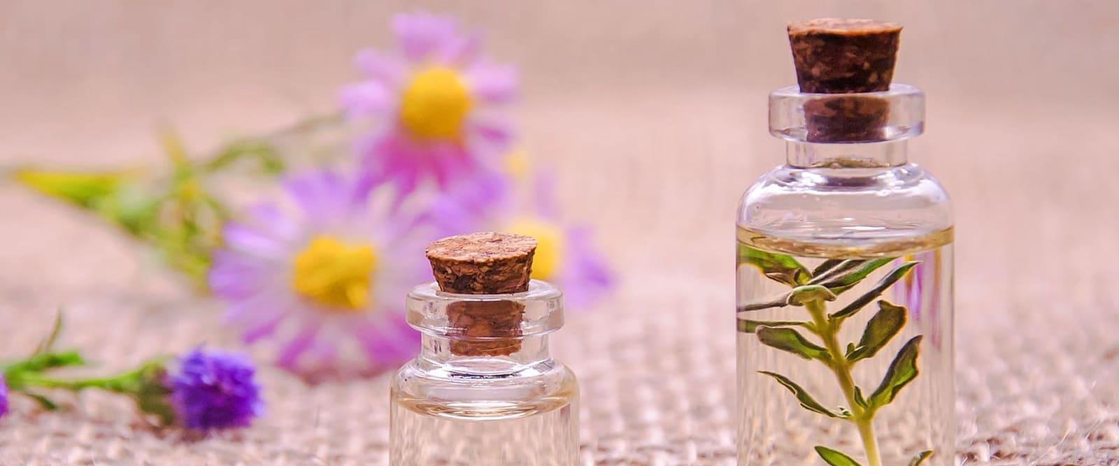 table with small coloured bottles of essential oils