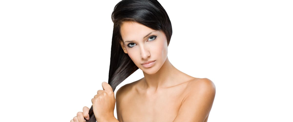 image of woman pulling on strong black hair