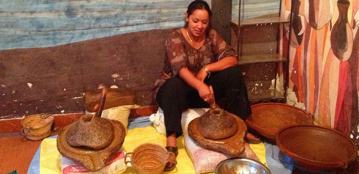 picture in morocco using stone wheel grinding argan nuts